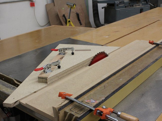 Panel for pew arm being cut to shape