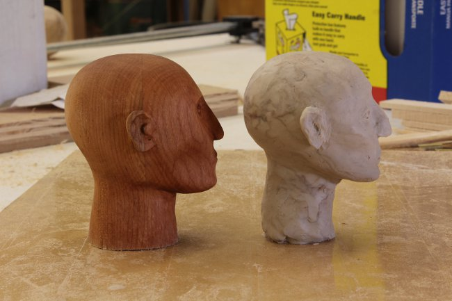 Comparing the clay model to the end product