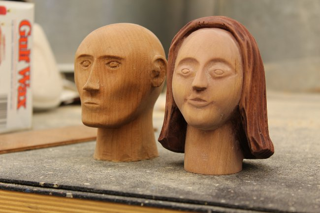 Facial view of two wooden heads