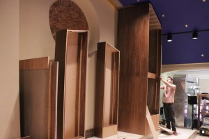 Austin Glidewell working on a large cabinet assembly