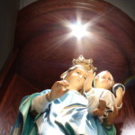 Statue of virgin and child illuminated from above