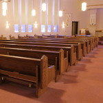 Left aisle showing completed pews after their retrofit