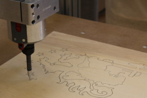 CNC used to draw patterns on plywood