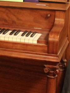 After shot of the repaired and refinished piano